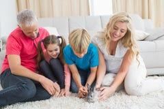 Happy family with pet bunny Stock Photo