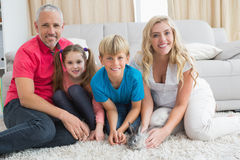 Happy family with pet bunny Royalty Free Stock Photography
