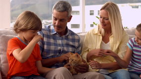 Happy family with pet cat stock video footage