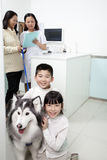 Happy Family with pet dog in veterinarian's office Royalty Free Stock Images