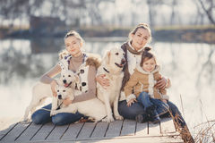 Happy family with Pets near the lake Stock Photography