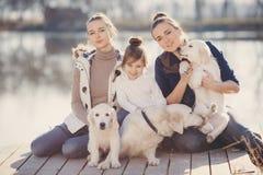 Happy family with Pets near the lake Stock Photos