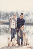 Happy family with Pets near the lake Royalty Free Stock Image