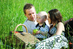 Happy family picnic Stock Images