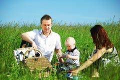 Happy family picnic Stock Photos