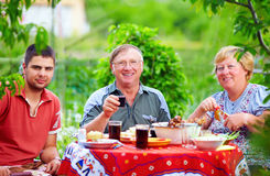 Happy family on picnic, colorful outdoors Stock Images