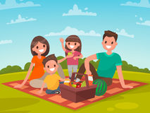 Happy family on a picnic. Dad, mom, son and daughter are resting Royalty Free Stock Photo