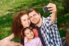 Happy family on a picnic Stock Photos