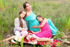 Happy family on picnic. Happy family young pregnant women and children daughters on picnic Royalty Free Stock Photo