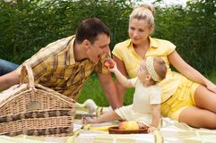 Happy family picnicking outdoors Royalty Free Stock Photo