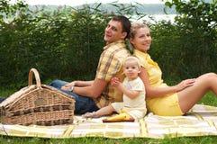 Happy family picnicking outdoors Royalty Free Stock Photos