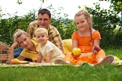 Happy family picnicking outdoors Stock Photo
