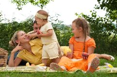 Happy family picnicking outdoors Royalty Free Stock Image