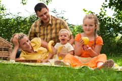 Happy family picnicking outdoors Royalty Free Stock Images