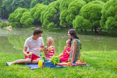 Happy family picnicking in the park Stock Photo