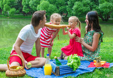 Happy family picnicking in the park and have fun Stock Photo