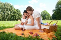 Happy Family picnicking in the park Royalty Free Stock Photos