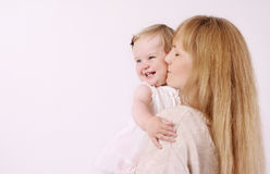 Happy family picture of caring mother and her cute little baby Royalty Free Stock Image