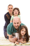 Happy family piled on top Stock Photos