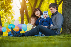 Happy family are plaing in the park Royalty Free Stock Photos
