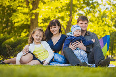 Happy family are plaing in the park Stock Images