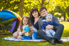 Happy family are plaing in the park Royalty Free Stock Image