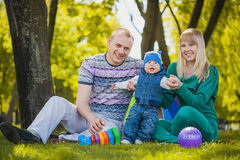 Happy family are plaing in the park Royalty Free Stock Photo
