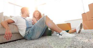 Happy family plans its future in a new home. Reliable investments Stock Images