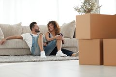 Happy family plans its future in a new home. Stock Photos