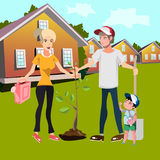 Happy family planting trees in courtyard Royalty Free Stock Photos
