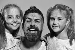 Happy family play. Childhood and holiday concept. Schoolgirls and man with beard. Happy family play. Childhood and holiday concept. Schoolgirls and men with Stock Photo