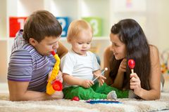 Happy family play musical toys Royalty Free Stock Image