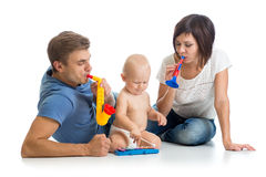 Happy family play musical toys Stock Photos