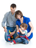 Happy family play musical toys Stock Photography