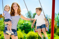Happy family on playground Royalty Free Stock Image