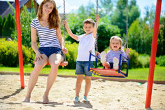 Happy family on playground Royalty Free Stock Photos
