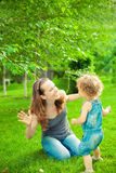 Happy family playing. In summer park royalty free stock photos