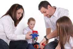 Happy family playing. Portrait of family father, mother, daughter and son stock photos