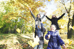 Happy family playing with autumn leaves Royalty Free Stock Photo