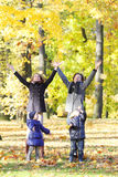 Happy family playing with autumn leaves Royalty Free Stock Photography