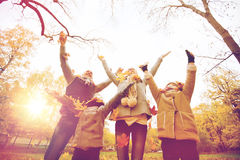 Happy family playing with autumn leaves in park Stock Photo