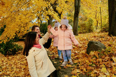 Happy family playing in the autumn in the park Stock Photography