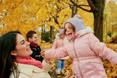 Happy family playing in the autumn in the park Stock Photos