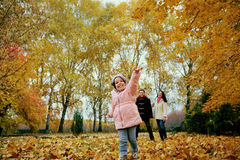 Happy family playing in autumn park. Stock Photography