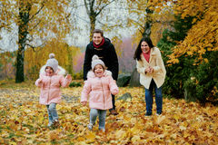 Happy family playing in autumn park. Stock Photo