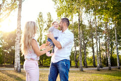 Happy family playing with baby child in the park. Happy family playing with the baby child in the park autumn summer stock image