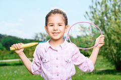 Happy family playing badminton Stock Images