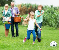 Happy family playing the ball Royalty Free Stock Image