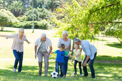 Happy family playing at the ball Stock Photo