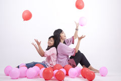 Happy Family playing with balloons. Mother and daughter playing with balloons Royalty Free Stock Photo